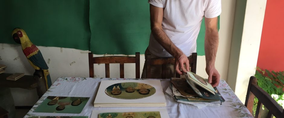 Urs Lehni looking through Tituts Riedl photopaintings collection in Crato (c) Bia Bittencourt
